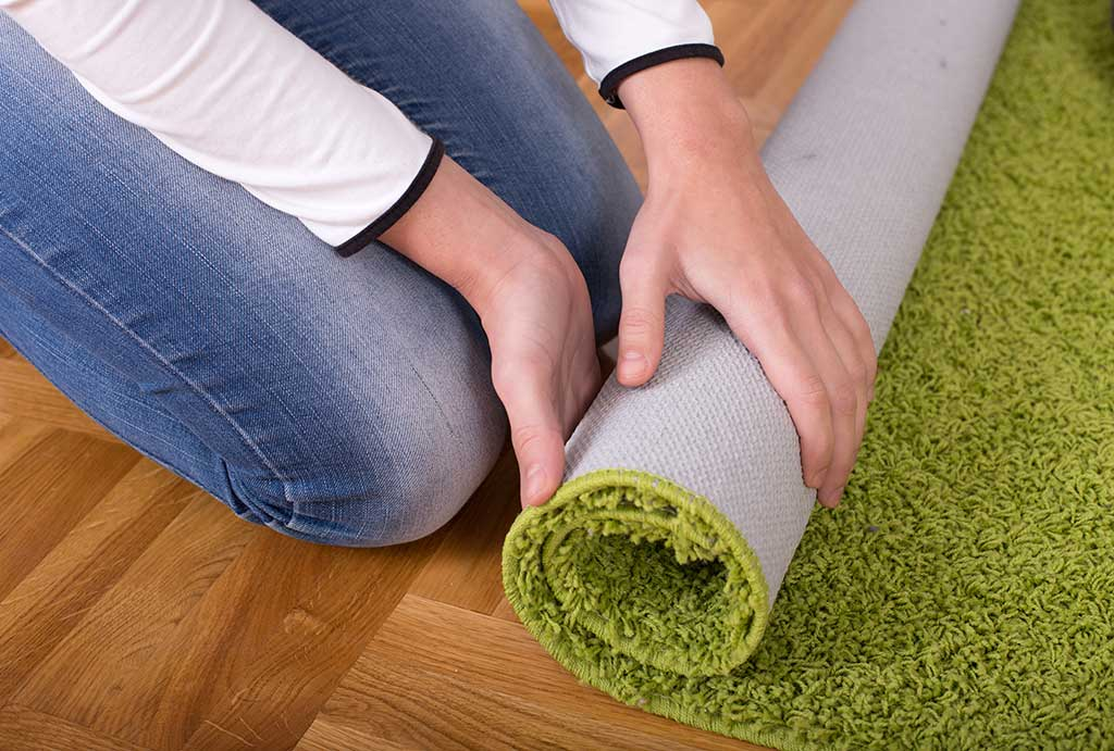 rolling-up-carpet-for-storage
